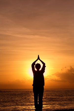 Silhouette of woman meditating at sunrise Stock Photo - 744124