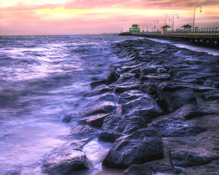 A HDR image of St. Kilda Beach (Australia) and Pier at twilight photo