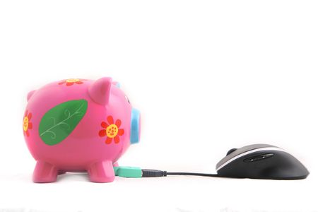 Isolated computer computer mouse and Piggy bank shot over white background. Stock Photo - 3407855