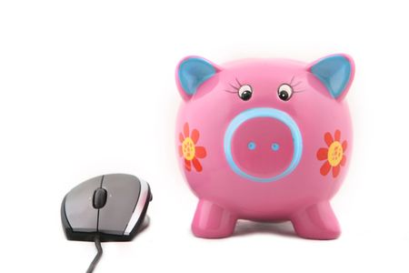 Isolated computer mouse and Piggy bank shot over white background. photo