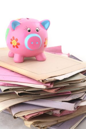 Isolated stack of folders with piggy bank at the top shot over white background Stock Photo - 3407914