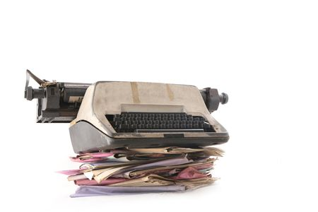 manage clutter: Isolated stack of folders with typewriter shot over white background Stock Photo