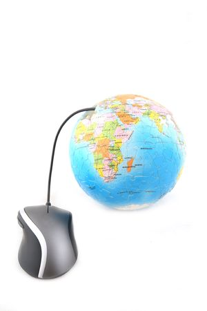 Isolated ergonomic mouse and a globe shot over white background photo