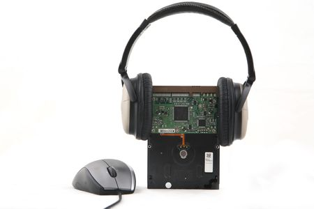 Isolated hard-disk with headphone and mouse shot over white background. photo