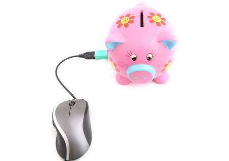 A hand clicking a computer mouse connected to a Piggy bank shot over white background. photo
