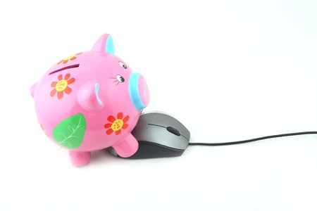 A piggy bank with computer mouse shot over white background photo