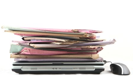 manage clutter: Isolated stack of folders with laptop computer shot over white background Stock Photo