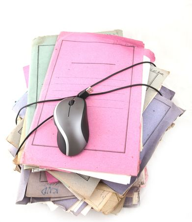 Isolated stack of folders with computer mouse shot over white background Stock Photo - 3438788