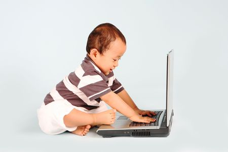 A happy toddler learn how to use a laptop computer Stock Photo - 3438785