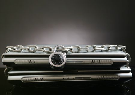 Two laptop computers with chain and lock photo