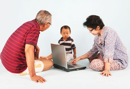 Learn how to use a laptop computer with grandpa and grandma photo