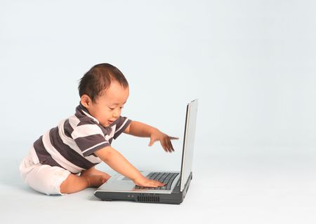An Excited toddler using a laptop computer. Stock Photo - 3500610