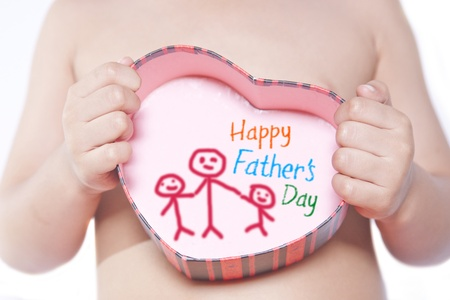baby open present: Toddler holding a heart shaped box with with pictures isolated on white