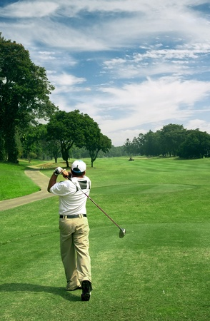 Golfer hitting the ball in a beautiful golf course Stock Photo - 9945131