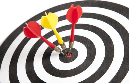Three Darts hitting the middle of dartboard Stock Photo - 10117947