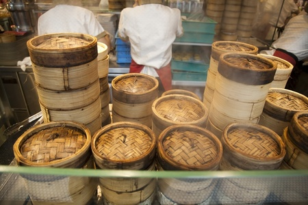 Stack of Dim Sum bamboo container arranged in the kitchen