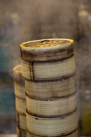 Stack of Dim Sum bamboo container arranged in the kitchen photo