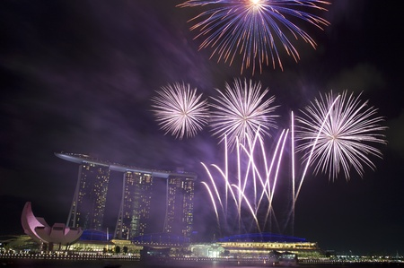Fireworks over Marina Bay Hotel and Resort during during Singapore National Day Parade 2011 Stock Photo - 10900397