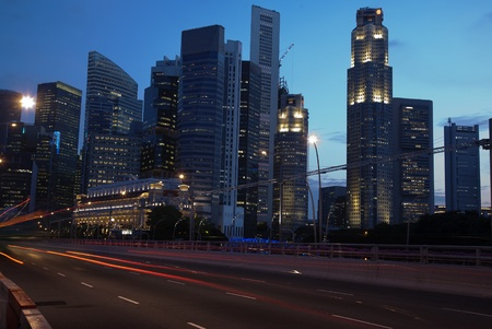 View of Singapore road and city skyline at twilight