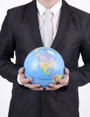 Businessman holding a globe showing the map of the USA photo
