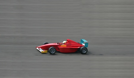 Red racing car shot with blurred background photo