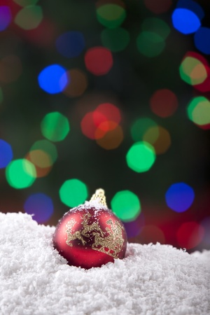 Christmas ball shot with snow and colorful background lights Stock Photo - 11204333