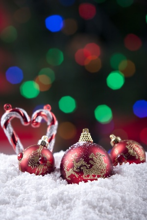 Christmas balls and candy cane decorations shot with colorful lights Stock Photo - 11204396