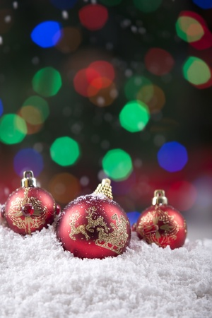 Christmas balls decoration shot with colorful defocused lights in background Stock Photo - 11204366