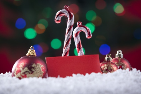 Christmas decorations with blank card shot on snow with colorful defocused lights Stock Photo - 11204398