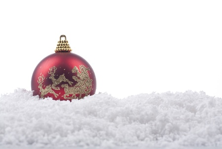 Christmas ornament over snow isolated on white Stock Photo - 11204323