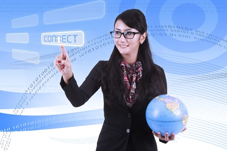 Businesswoman with binary code background touching the connect button photo