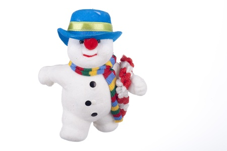 Snowman with blue hat isolated on white photo