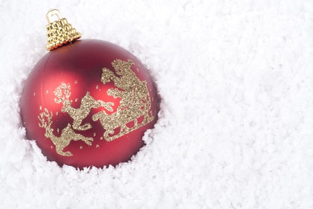 Christmas ornament ball with snow background Stock Photo - 11204414