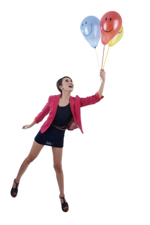 Conceptual photo of businesswoman flying with balloons