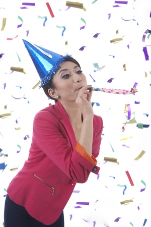 Businesswoman blowing trumpet celebrating new year  photo