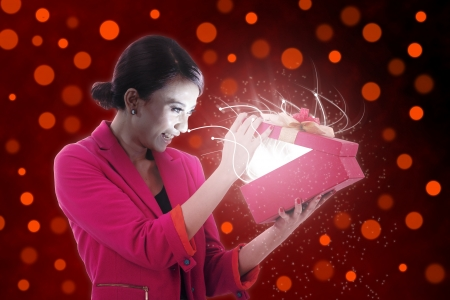 Woman excited opening a present Stock Photo - 14684492