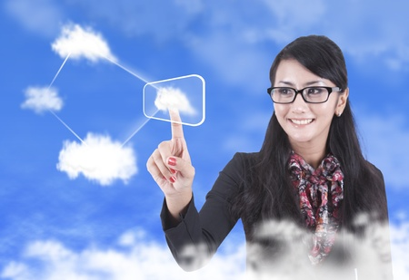 cloud network: Asian woman touching a touchscreen with cloud networking concept Stock Photo