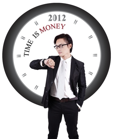 Asian businessman in suit isolated on white with big clock n this back photo