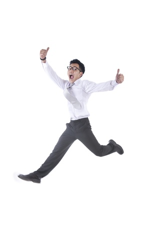 jump suit: Asian businessman jumping with two thumbs up isolated on white