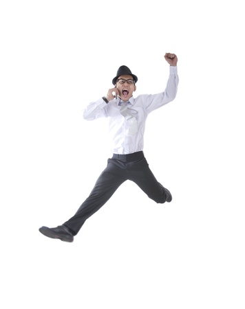 air jump: Businessman with hat on the phone jumping isolated on white