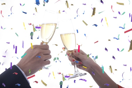 Man and Woman celebrating with champagne photo