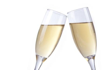 brindisi spumante: Brindisi con champagne bicchierini su sfondo bianco