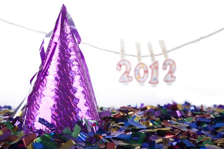 Party Hat with confetti and 2012 candles isolated on white photo