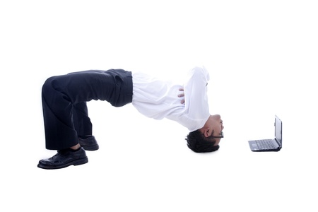 tricky: Young asian businessman with his acrobatic moves