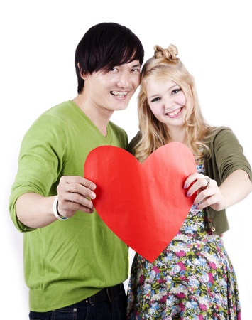 mix race: Happy mix race couple holding a heart sign isolated on white  Stock Photo