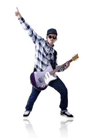Passionate guitarist with sunglasses and hat isolated on white  photo