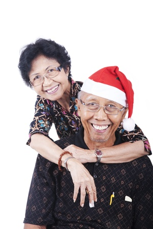 Happy asian senior couple celebrating christmas photo