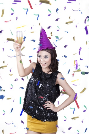 causcasian: Causcasian woman with champagne having fun in the party wearing pary hat