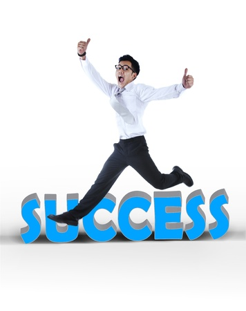Excited asian businessman jumping showing thumbs up isolated on white photo