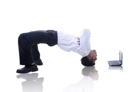 Asian businessman with his acrobatic move and a laptop photo